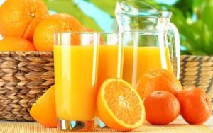 hạ huyết áp bằng nước cam